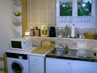 Bild der Ferienwohnung Raabe mit Küchenansicht